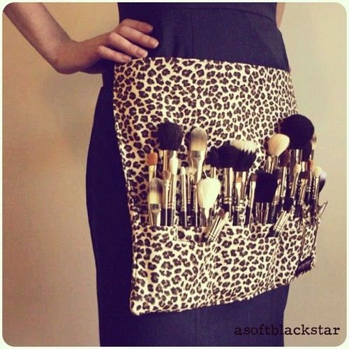 Make-Up brushes in an cheetah print brush apron
