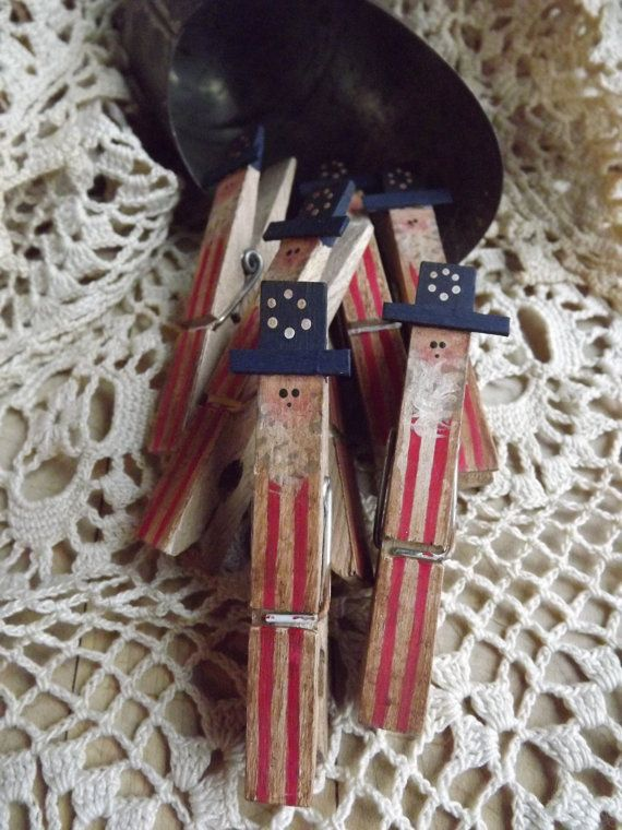 Grungy Primitive Uncle Sam Painted Wood Clothespins! You will receive a set of 5. I hand paint these on one side only then finished them all over with an antiquing gel for a primitive antique look. They will make a nice addition to your Americana Home Decor. I love to use them as an oversized paperclip or to hold the snack bags closed. They make a great teacher or hostess gift. So many uses for them! These are standard size clothespins. These are made to order. You will not receive the o...
