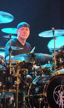 Neil Peart.....Great songwriter, and oh yeah, he plays a little drums too.