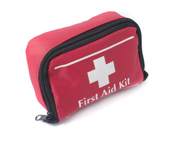 Free Stock Photo: A red colored first aid bag with medical supplies inside - By…