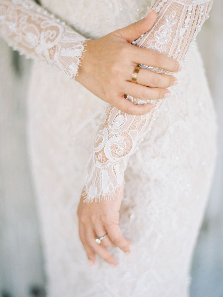 Eyelash lace long sleeve wedding dress: http://www.stylemepretty.com/2015/12/02/lush-bali-wedding-at-the-khayangan-estate/ | Photography: Angga Permana - http://anggapermanaphoto.com/