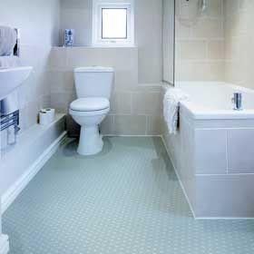 Blue vinyl flooring tiles in a bathroom