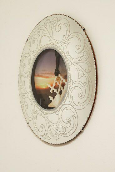Sofia Tekela-Smith.  Tiny clouds Small mountains 2.  2012.  390mm diameter.  gold lip mother of pearl, pounamu, wax thread photograph, mirror.