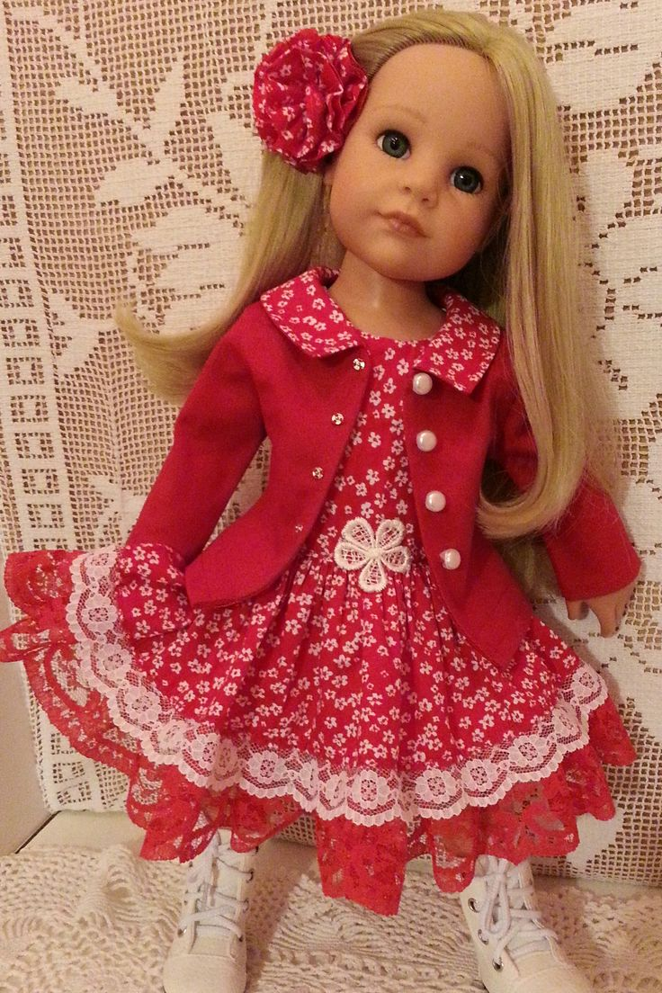 Hannah Gotz in a Salstuff Red fitted Jacket with floral collar, matching her Red Ditsy Floral summer dress with white and red lace. Peony style Salstuff handmade Hairclip.