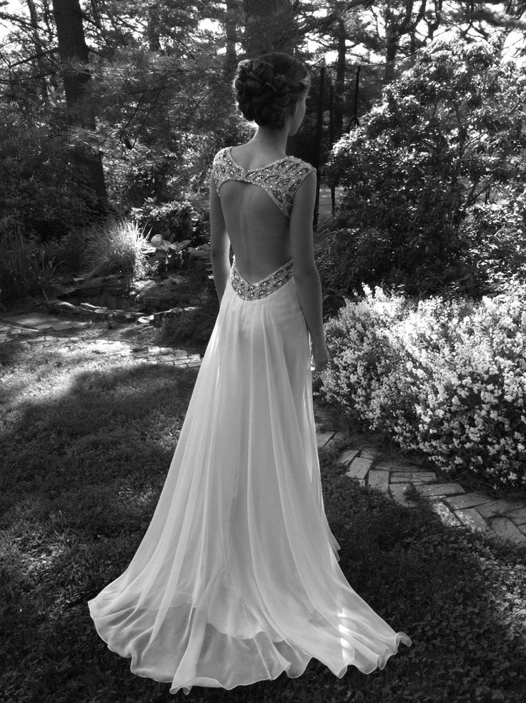 This dress reminds me of like something the great gatsby mostly because if the bead work and the overall of the style dress. It also gives off a little bit of a wedding dress kind of look. Any how this dress is beautiful and I  love the round train it is becoming a popular trend that I absolutely love -Brendalyn