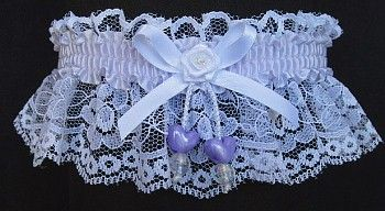 Delicate & Irresistible. White lace and LILAC MIST Garter with satin band & lilac double hearts. Mini-rose with an opal pearl eye in the center of the bow. Lilac Garter for Wedding Bridal Prom Fashion. Style # FM-2AN-420 / Visit: www.garters.com/page13a.htm