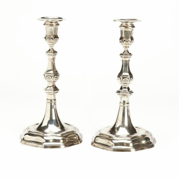 Two Dutch silver candlesticks, Nijmegen Knopped baluster stem on shaped round base with waved band decoration. With detachable plain round shaped drip pans. Maker Severijn Schiff (makers' mark struck twice), Nijmegen, around 1770. H. ca. 24 cm.