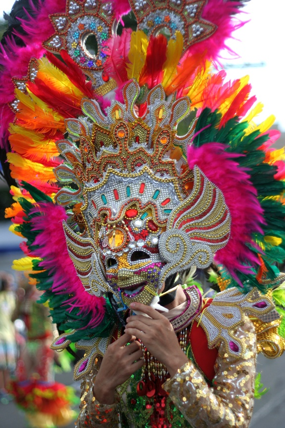 A COLORFUL HEADDRESS AND MASK WORN by a dancer of the MassKara Festival, an annual celebration of Bacolod City, Philippines | Photo by Julius D. Mariveles
