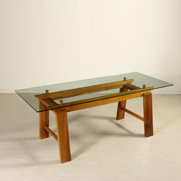 Tavolo anni 70-80; base in legno di noce, piano in cristallo.