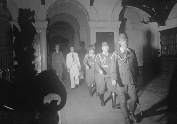 WAR FAR EAST BURMA CAMPAIGN 1941-1945 (SE 4593) The Surrender Ceremony at Rangoon 28 August 1945: General Numata Takazo leads the Japanese delegation to sign the surrender of the Japanese Southern Army at Rangoon.