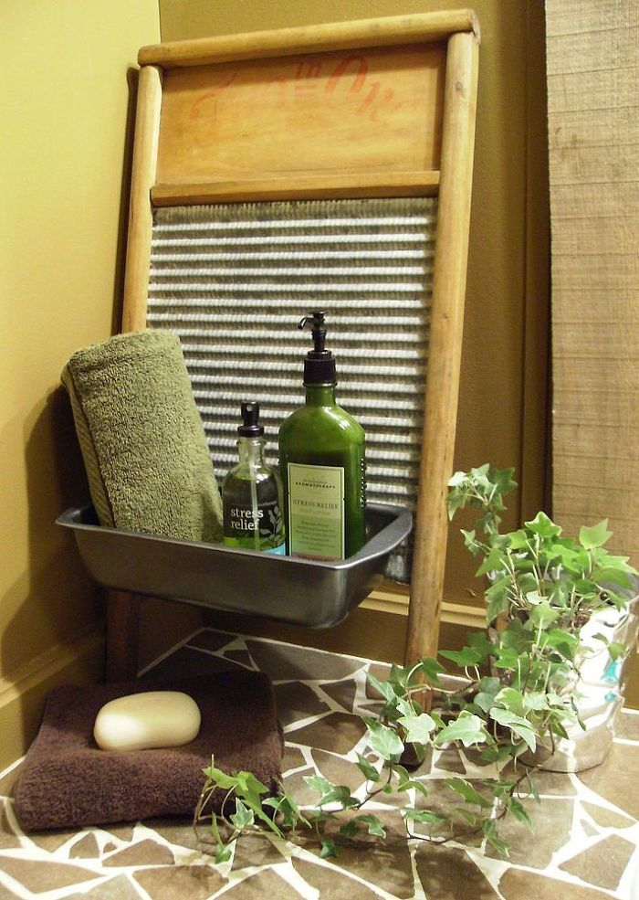 Bathroom Makeover - An antique washboard and an old bread tin were screwed together to make a caddy for toiletries. Unused ceramic tiles were smashed up, glued…