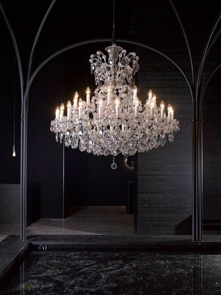One of our Maria Theresa inspired chandeliers. #milandesignweek #euroluce2015 #salonedelmobile #crystal #interiordesign #design #chandelier #mariatheresa #glass #light #craftsmanship #preciosalighting #bohemiancrystal