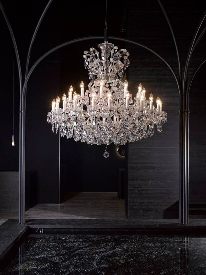 One of our Maria Theresa inspired chandeliers. #milandesignweek #euroluce2015 #salonedelmobile #crystal #interiordesign #design #chandelier #mariatheresa #glass #light #craftsmanship #preciosalighting #bohemiancrystal