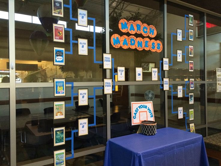 March Madness--library style: I really like how this one is set up on the windows. Our teen section will have a wall like this when it finally is finished.