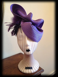 I like how the milliner placed, what appears you be, textured fabric over the styrofoam head.