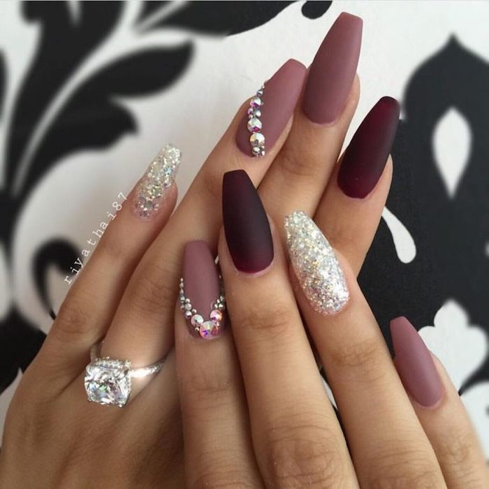 dark maroon and ashen rose matte nail polish, decorated with silver glitter and …