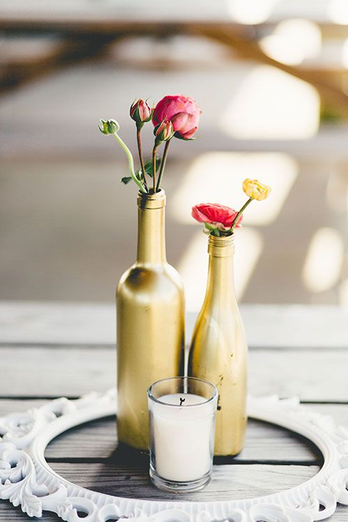 599 best images about wedding centerpieces on pinterest for Gold wine bottle centerpieces