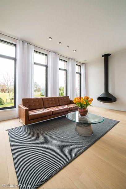 Zithoek - living room - woonkamer - sofa - Zanotta - flowers - bloemen - tapijt - carpet - Kasthall
