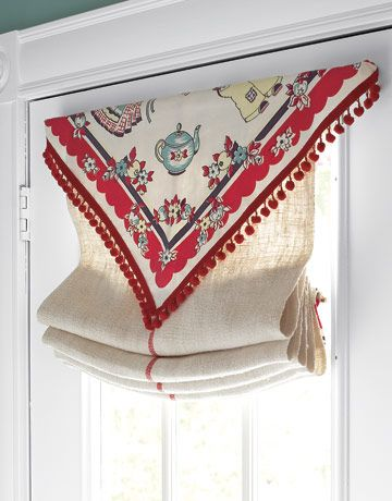 Repurposed Tablecloth  A vintage tablecloth with pom-pom fringe becomes a cheerful topper to a kitchen door window treatment.