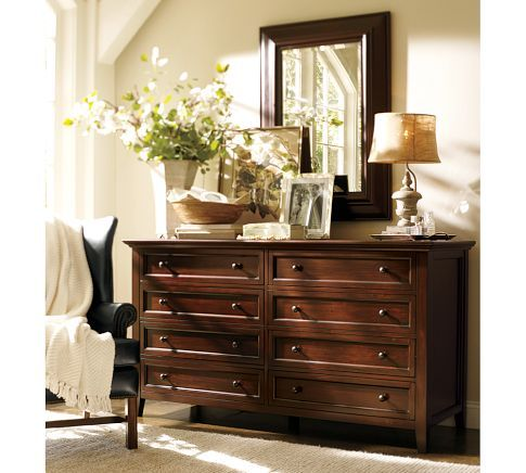 Dresser With Hanging Mirror Above Layered Art Leaning Against Mirror Table Top Picture