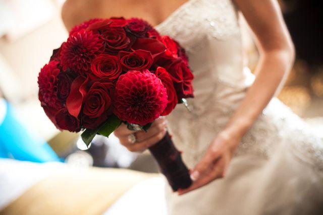 Bride bouquet: red dahlias, red roses, black magic roses, and burgundy callas