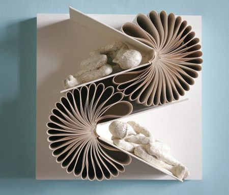 Wonderful sculptures made by Daniel Lai with books and small characters interacting with these books.
