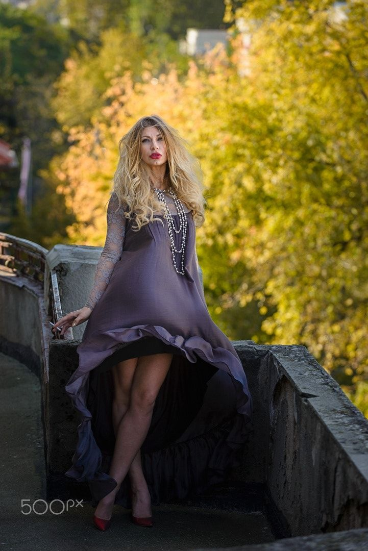 Balcony scene - Fashion photo shoot in Bucharest with Catalina