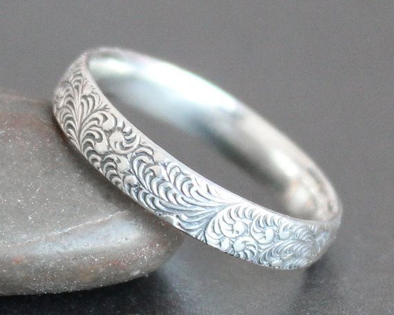 This seller does patterns, bezels, and rose gold. Not sure if patterns can be done on rings thinner (eg, are they cast, or stamped, or engraved?).   Feather Pattern Ring in Sterling Silver - Alternative Wedding Band - Made to Order - Art Deco - Art Nouveau