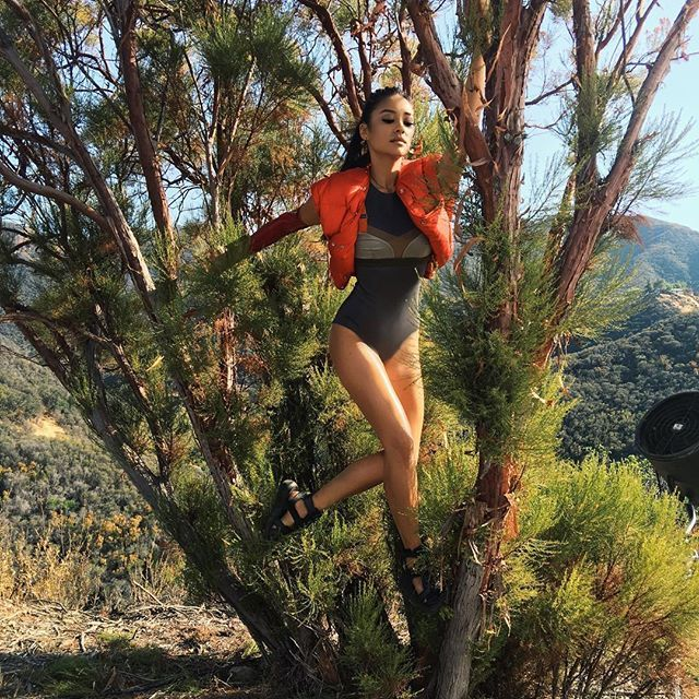 """This is normal tree climbing attire, no? Working on my best """"katniss"""" during my @selfmagazine shoot, on stands now 🌲💃🏻"""