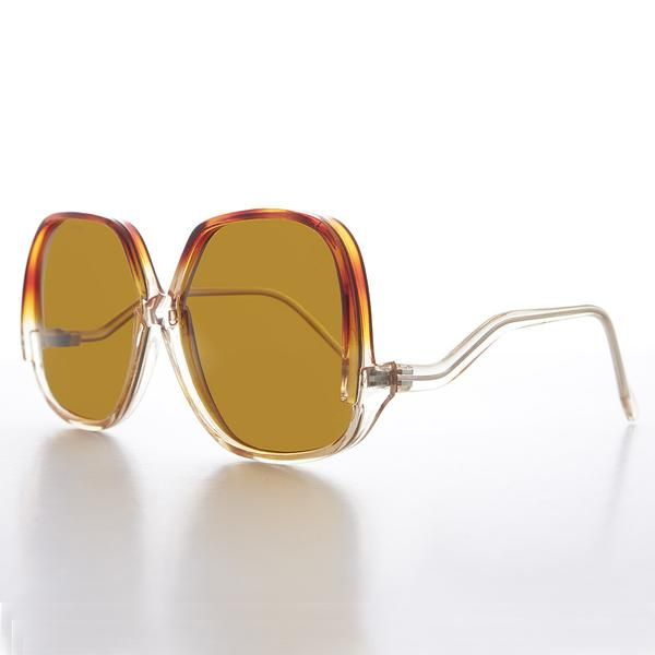 57b3e91dbe9f The chic, square, oversized frame compliments most face shapes. Made with  quality acetate plastic with metal hinges.