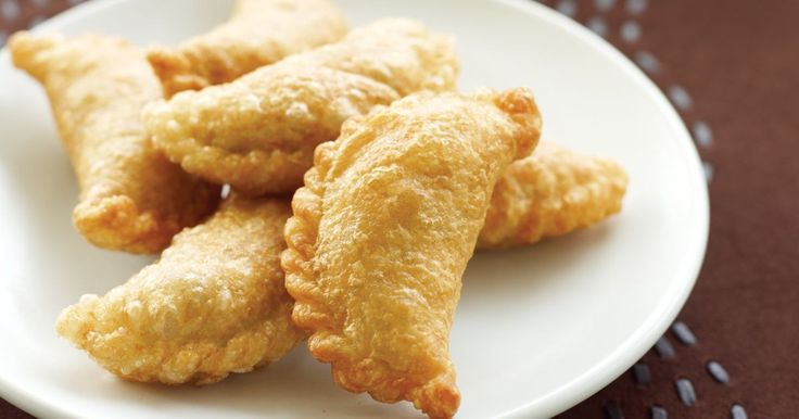 Cucumber dipping sauce offers a refreshing contrast to these spicy curry puffs.