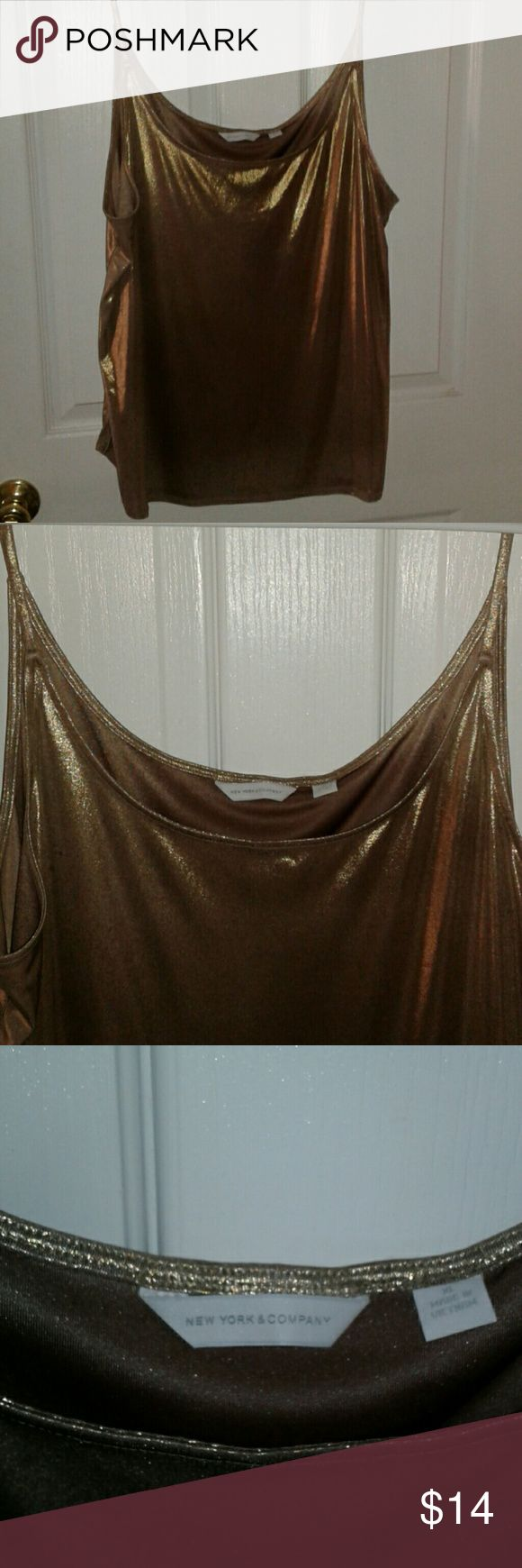"""Gold Lamar scoop neck holiday top-XL A really festive dress up gold metallic spaghetti strap top.Straight bottom hem. Semi fitted  Measurements approx: Strap to bottom-28"""" Arm pit to arm pit'- 21""""(I believe you double this) New York & Company Tops"""
