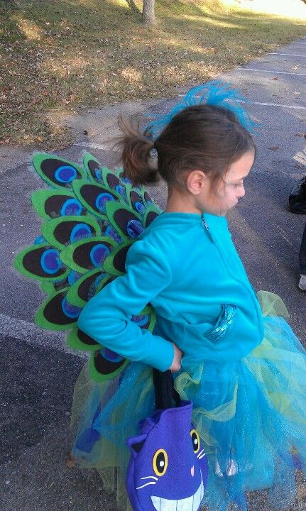 Peacock costume with felt feathers and a tutu.
