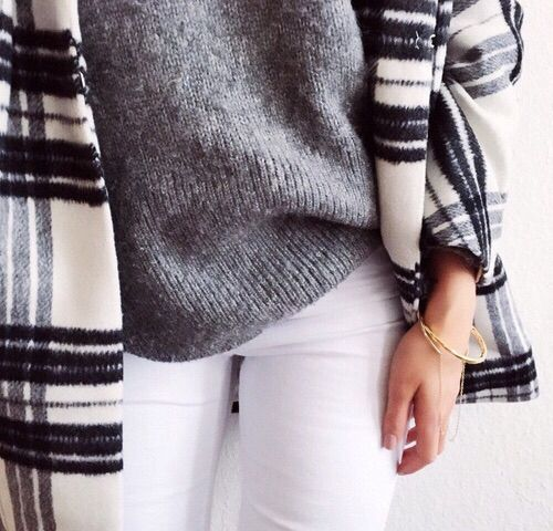 Raw cream and black plaid pattern plus grey sweater and stark white jeans