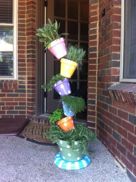 These topsy-turvy pots are the cutest way to create a vertical wall garden perfect for the front porch or patio area. You can get as whimsical as you'd like with this design concept since this would also make a great do it yourself project fit for the entire family. You could even throw one of these together as a kit and gift it to someone you love.