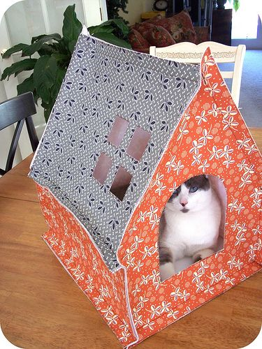 Tutorial: Sew this cat house. I love this, but I know it would be a waste of time because cats won't sleep in anything specifically intended for them. Let's call it a baby playhouse instead, then they'll be all over it.