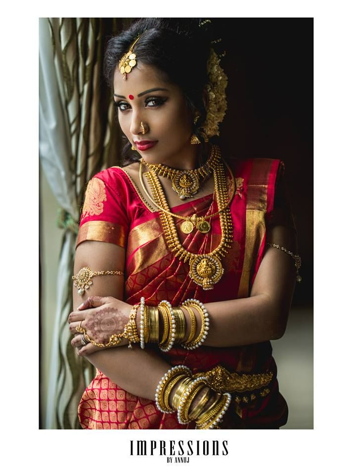 South Indian bride. Temple jewelry. Red silk kanchipuram sari.Braid with fresh flowers. Tamil bride. Telugu bride. Kannada bride. Hindu bride. Malayalee bride