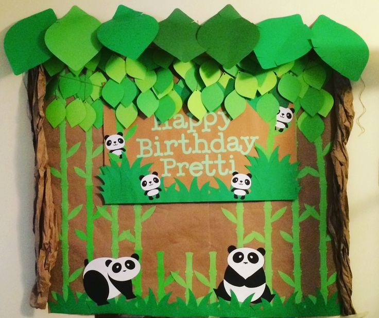 Panda themed Party Backdrop - Used butcher paper to create the branches on the side. I used my cricut to cut out all the leaves, pandas and bamboo.