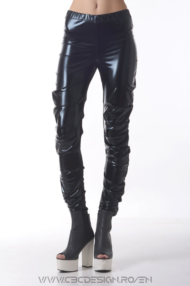 Black lacquered leggings based on a circular pattern that makes them wrap around the leg beautifully. Sport - chic and casual at the same time, they make a statement for sure.