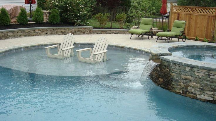 Custom swimming pool with sun-shelf and raised spa
