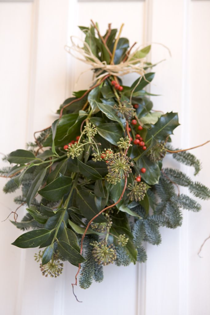 Homemade Christmas: Make a door decoration by tying together holly, ivy and pine trimmings. Photo by Sarah Cuttle.