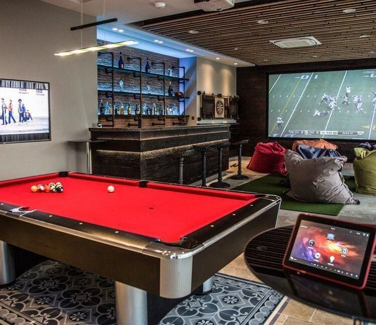 Add a Bar to Your Man Cave - Man Cave Home Bar Think that screen is big enough? Grab a bean bag chair and enjoy the weekend. Game Room Basement, Man Cave Basement, Man Cave Garage, Basement Bedrooms, Bedroom Boys, Basement Sports Bar, Garage Game Rooms, Game Room Bar, Man Cave Designs