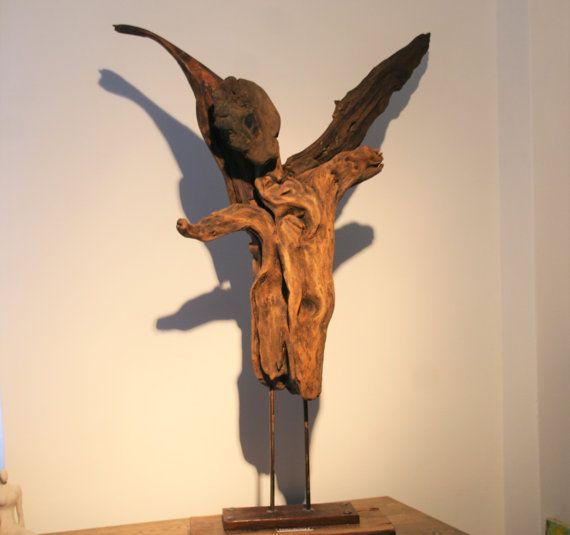 Driftwood sculpture the Fallen Angel(SAVE A TREE LINE)