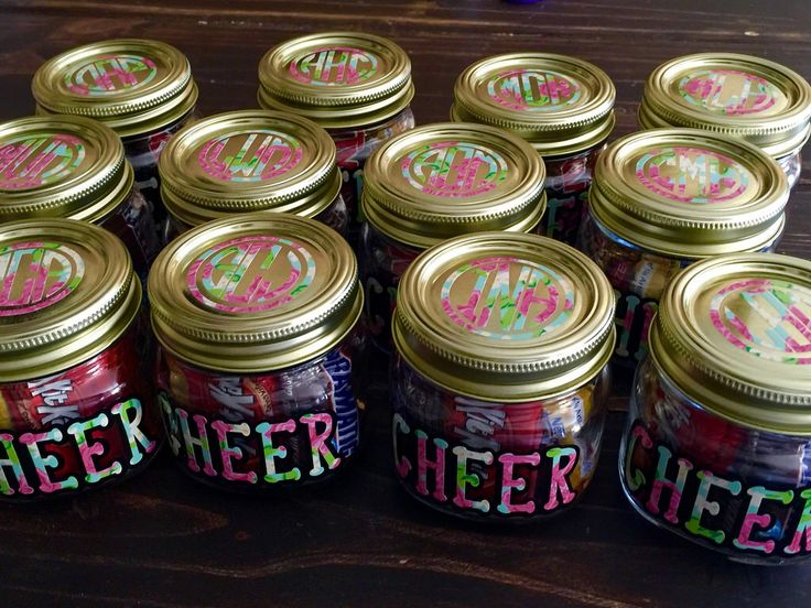 Monogrammed Cheer mason jars filled with candy; cheer camp swag bags.