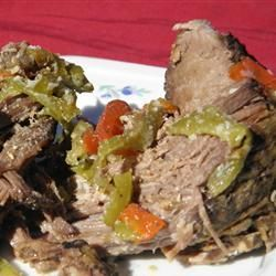 "Grandma Maul's Italian Beef | ""Seasoned with garlic, anise, and sesame seeds, chuck roast is slowly simmered in a crock pot for a delicious Italian Beef."""