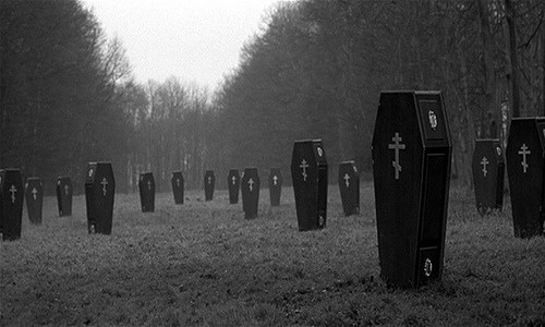 coffins- beautifully creepy photo, but makes me think of fema camps....
