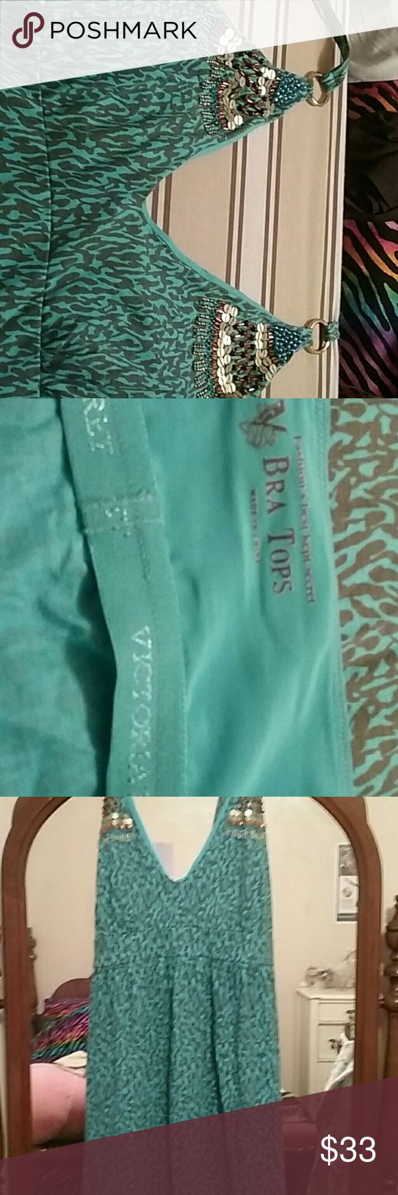 Victoria's Secret beach dress with built-In bra. EUC.  Size L.  Just above knee length.  Beautiful blue animal print.  Tirs behind neck.  Beautiful heading on top. Victoria's Secret Dresses Backless