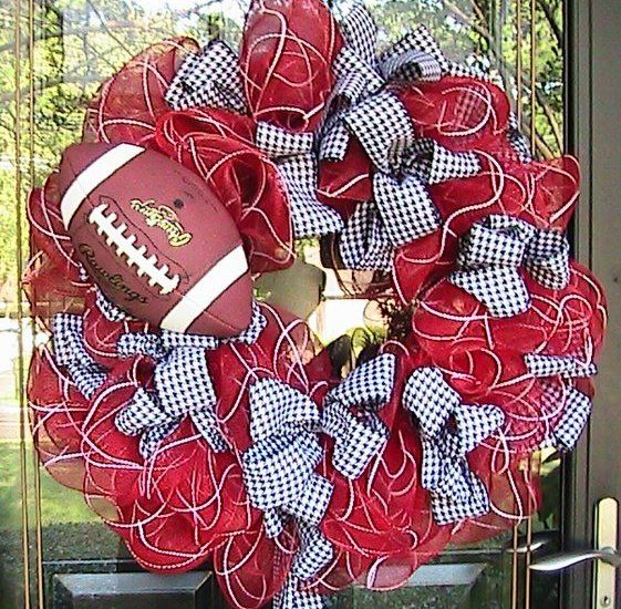 @Miranda Watts - maybe you could do the Auburn version of this for your fall wall wreath?  You could use navy deco mesh ribbon and then an orange and blue striped ribbon to go with it.  Finish it off with a football, or perhaps a stuffed Aubie ... or even an eagle?!?  :)