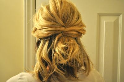 This is one of my favorite ways to style my hair, especially when it's styled curly to begin with. All you need is a few good bobby pins and hairspray! It is a great half-up option that can so easily be turned into a super cute updo