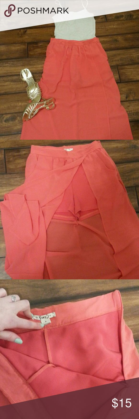 Sheer Coral Maxi Skirt Size S. Coral shorts underneath and a slit that goes up to the waist. Zipper on the side and pockets because who doesn't love those! Super cute and breezy. Perfect for a walk on the beach in style! Very J Skirts Maxi
